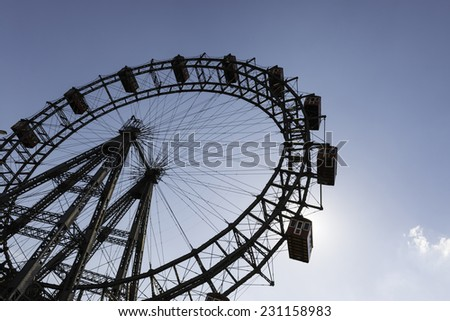 Silhouette of the old Giant Ferris Wheel in the amusement park Prater in Vienna, Austria. - stock photo