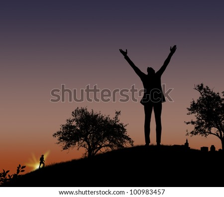 Silhouette of the person on a hill - stock photo