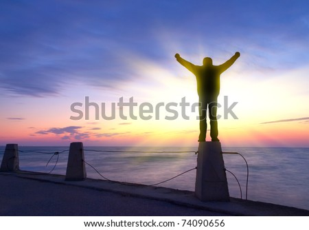 Silhouette of the person on background bright sky during sundown. Abstract composition - stock photo