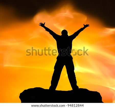 Silhouette of the person on fired background - stock photo