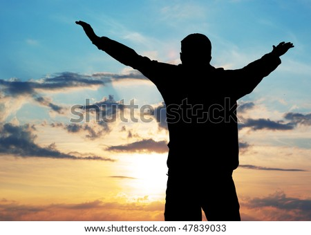 Silhouette of the person who fly to Sun. Element of design. - stock photo