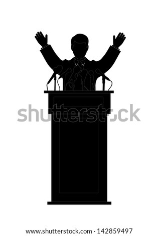 silhouette of the politician before a microphone - stock photo