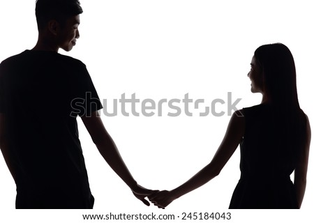 silhouette of two lovers. Isolated on white background - stock photo
