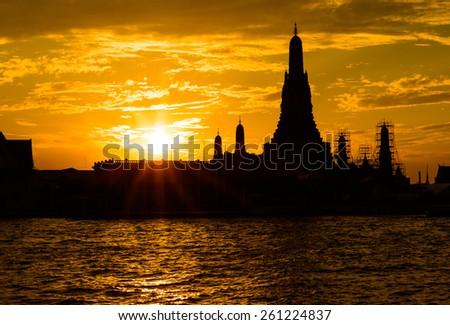 Silhouette of Wat Arun Temple in bangkok thailand - stock photo