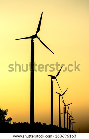 Silhouette of wind turbine - stock photo