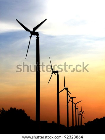 silhouette of wind turbine generating electricity - stock photo