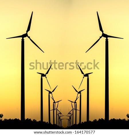 Silhouette of wind turbine power generation - stock photo