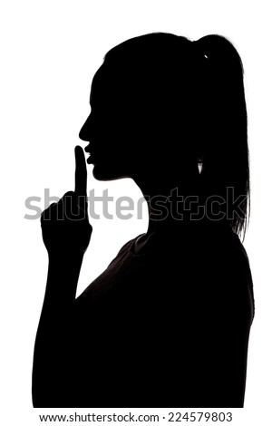 silhouette of woman holding finger on her lips - stock photo