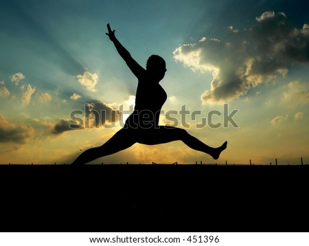 Silhouette of Woman Leaping - stock photo