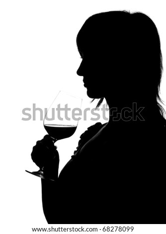 Silhouette of woman smelling red wine isolated on white - stock photo