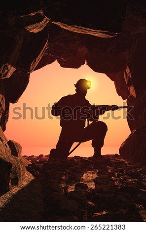Silhouette of worker in the mine. - stock photo