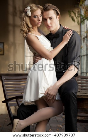 Silhouette of young adult couple in love posing in classic elegance clothes to date - stock photo