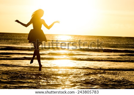 silhouette of young happy woman on water background, outdoor portrait, summer vacations - stock photo