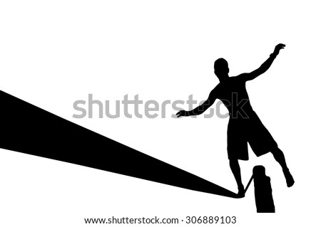 Silhouette of young man balancing on slackline. Slackliner balancing on tightrope silhouette. - stock photo
