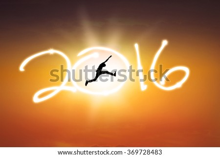 Silhouette of young man jumping on the sky while celebrating new year 2016 at sunset time - stock photo
