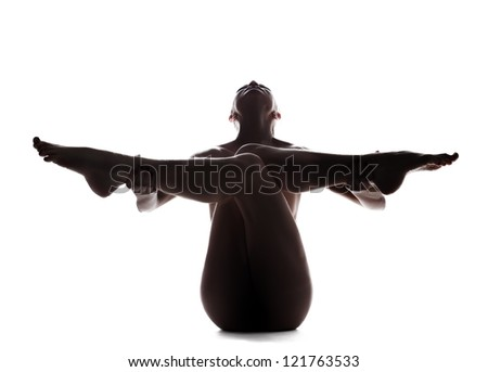 Silhouette of young nude woman - stock photo