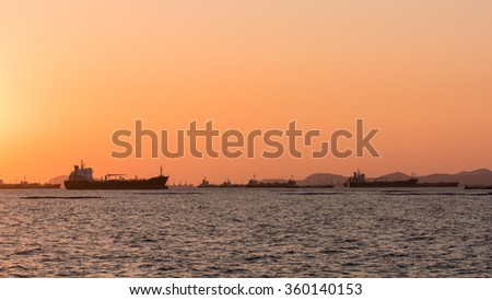 Silhouette Oil tanker, Gas tanker with Container Ship - stock photo