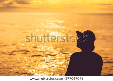 silhouette people alone sunset on the sea, Sun sky relaxing with water - stock photo