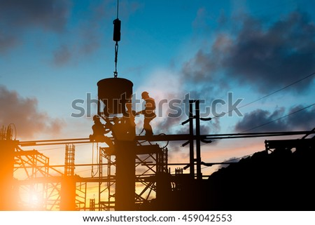 Silhouette People heavy industrial sector construction worker engineer follow the direction on the scaffolding over blurred natural background sunset pastel. Heavy industry and safety at work concept. - stock photo