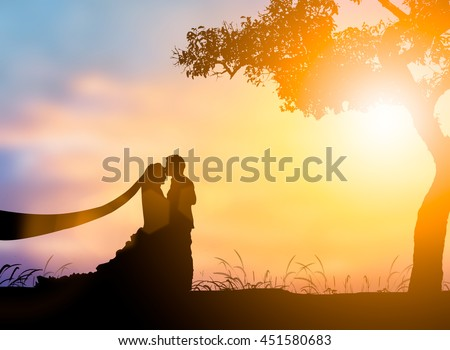 Silhouette People picture of the man and girl wedding over blurred beautiful nature pastel.wedding and lovers and People concept. - stock photo