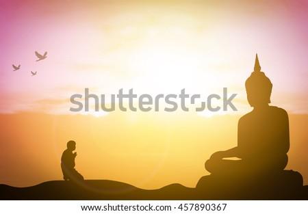 Silhouette people pray from buddha statue to hope for help on sun set and bokeh background. Inspiration from help to hope, Vesak Day, Wesak, Jayanti, Visak Bohea, Visakha Bucha, Buddha Purnima concept - stock photo