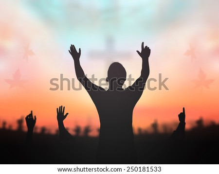 Silhouette people raising hand over blurred crown of thorns and the cross on golden autumn sunset background. Worship, Forgiveness, Mercy, Humble, Evangelical, Reconcile, Redeemer Thanksgiving concept - stock photo