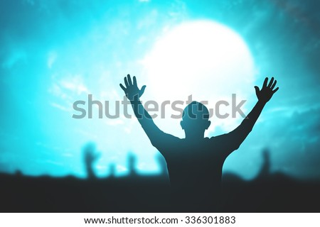 Silhouette people raising hands over blur blue light night sky background. Responsibility, Worship, Forgiveness, Mercy, Humble, Repentance, Reconcile concept. - stock photo