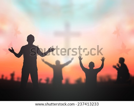 Silhouette people raising hands over blur crown of thorns and the cross on autumn sunset background. Worship, Forgiveness, Mercy, Humble, Repentance, Reconcile, Adoration, Glorify, Redeemer concept. - stock photo
