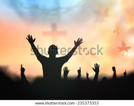 Silhouette people raising hands over blur crown of thorns and the cross on golden autumn sunset background. Thanksgiving, Christmas, Forgiveness, Mercy, Humble, Repentance, Reconcile, Glorify concept. - stock photo