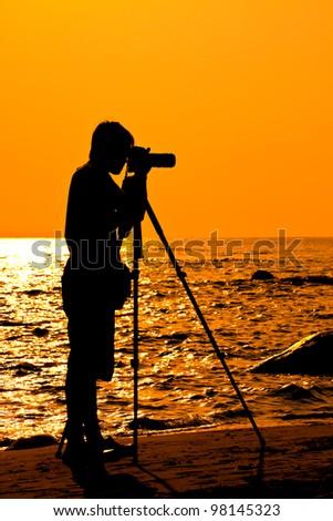 Silhouette Photographer on the beach, Thailand - stock photo