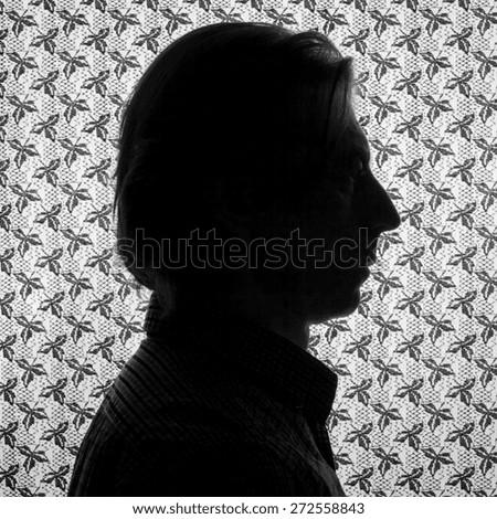 Silhouette portrait of a man in profile. - stock photo
