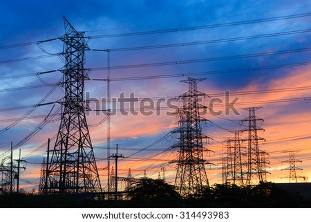 Silhouette power transmission tower  during twilight time - stock photo