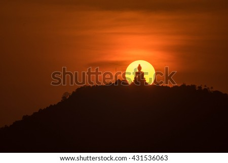Silhouette public big white Buddha, sunset in Thailand - stock photo