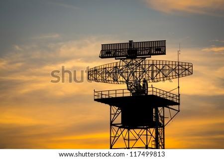 silhouette radar tower plane - stock photo