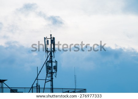 Silhouette repeater internet antenna with sky and background - stock photo