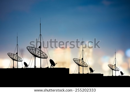 Silhouette Satellite dish in city communication technology network image - stock photo