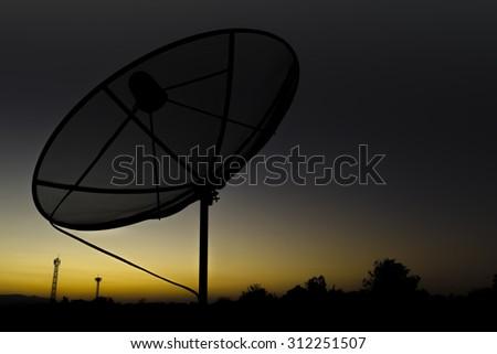 Silhouette Satellite sky sunset dish transmission data network on nature background . - stock photo