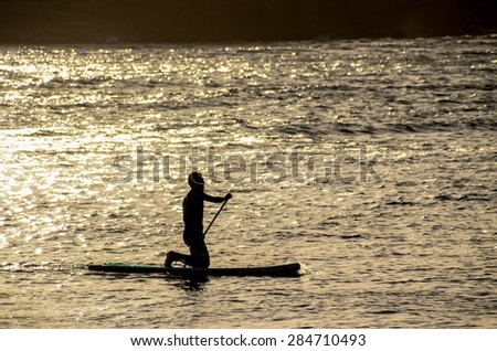 Silhouette Surfer at Sunset in Tenerife Canary Island Spain - stock photo