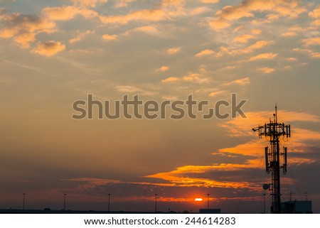 Silhouette Telecommunication tower on sunset  background - stock photo