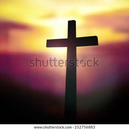 Silhouette the cross on blurred sunset background. - stock photo