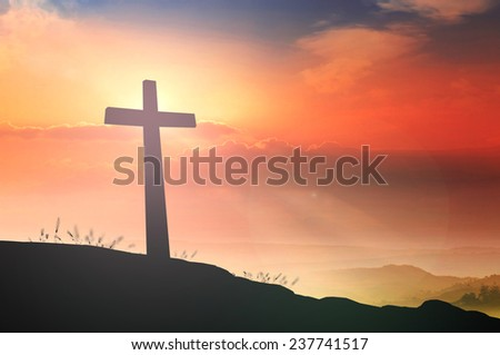 Silhouette the cross over a sunset background. Christmas background, Worship, Forgiveness, Mercy, Humble, Repentance, Reconcile, Adoration, Thanksgiving, Redeemer, Redemption, Trust, Love concept. - stock photo