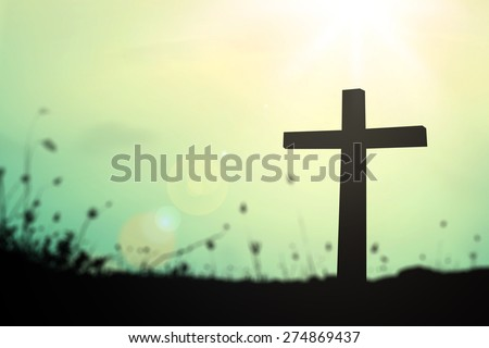 Silhouette the cross over blurred sunrise background. - stock photo