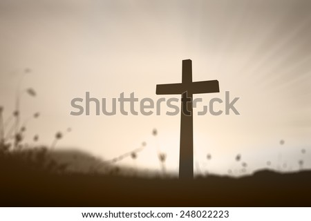 Silhouette the cross over over blurred beautiful sunset with amazing light background. Christmas background, Forgiveness, Mercy, Humble,  Evangelical, Reconcile, Adoration, Glorify, Redeemer concept. - stock photo