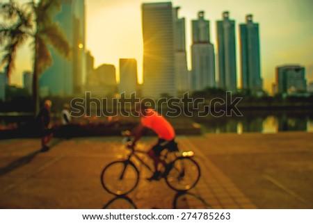 Silhouette,The man biking taken with low speed shutter,motion blur - stock photo