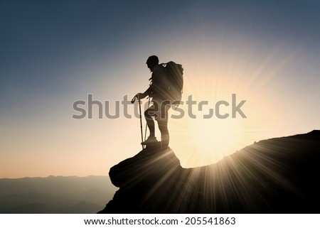Silhouette tourist with backpack in beautiful sunset  summer  landscape mountain, adventure hobby extreme tracking - stock photo