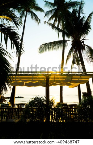 silhouette view with bower on the beach at sunset time - vintage filter with boost up color processing - stock photo