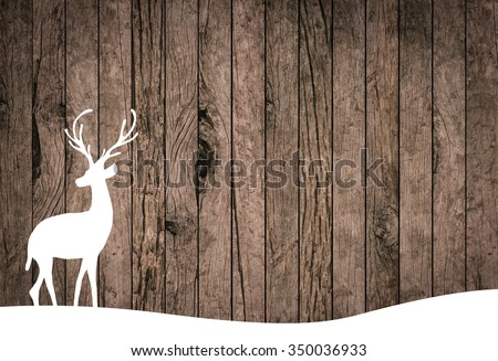 silhouette white reindeer over grunge wood striped panel background for banner,design,decorate:xmas backdrop seasonal:merry Christmas festival and new year wallpaper concept.silhouette with path. - stock photo