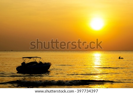 Silhouette yacht  in yellow sunset moment, - stock photo