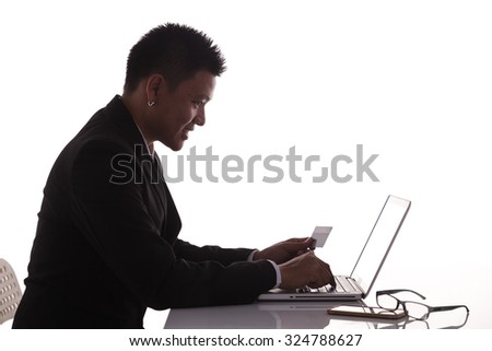 silhouette young business man making online payment - stock photo