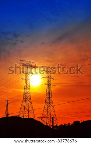 Silhouetted electrical power supply tower on sunset - stock photo